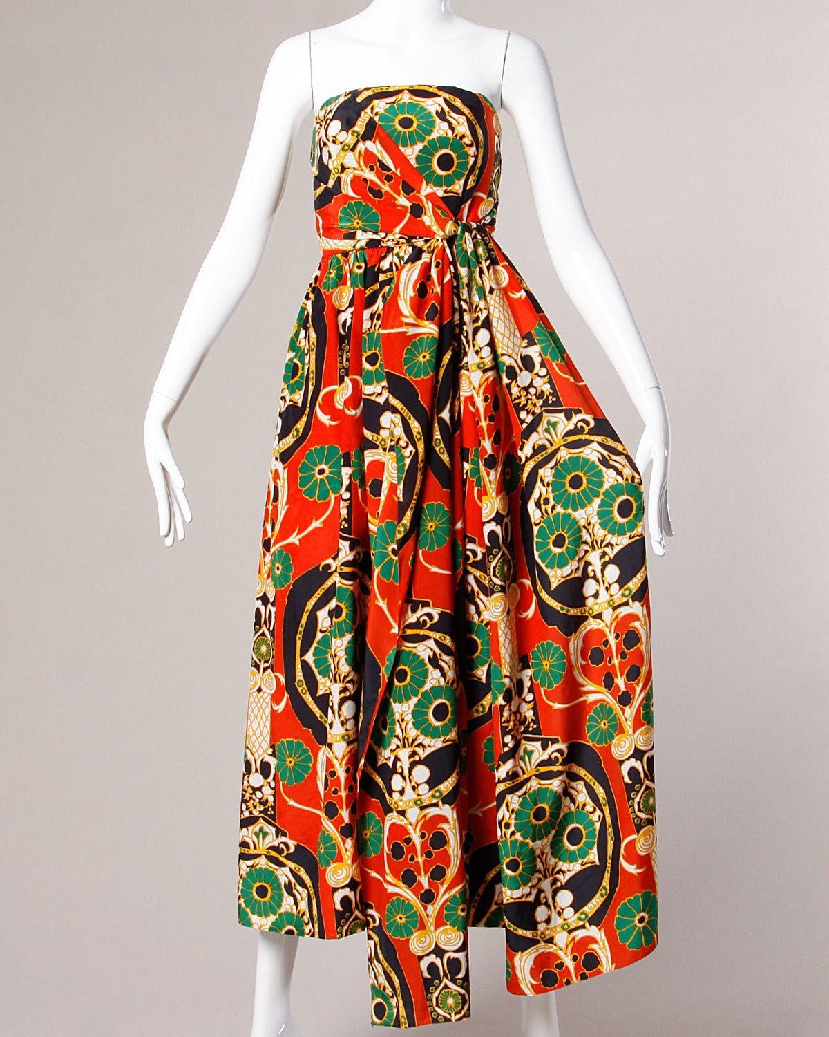 Reduced from $1895. Stunning vintage two-piece ensemble by Donald Brooks featuring a strapless wrap-style gown and matching capelet. Both pieces are done in a vibrant Asian-inspired printed creamy silk and can be worn separately as well as together
