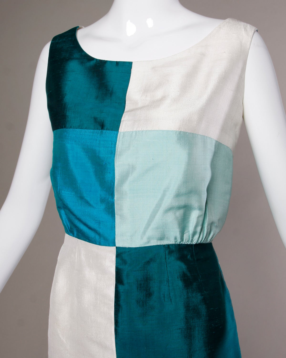 Simple and chic silk dupioni sheath dress in color blocked shades of blue.