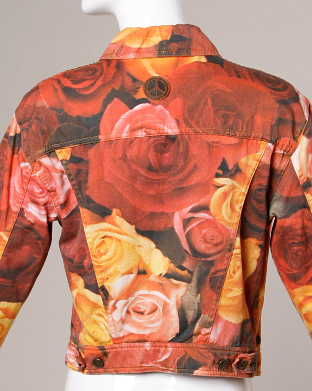 Light weight vintage denim jacket by Moschino with a photo floral print.  Details:  Unlined Front Button Closure/ Button Closure At Wrist Marked Size: I 44/ US 10/ F 40/ D 40/ GB 14 Color: Yellow/ Orange/ Rouge/ Green Fabric: Cotton Label: