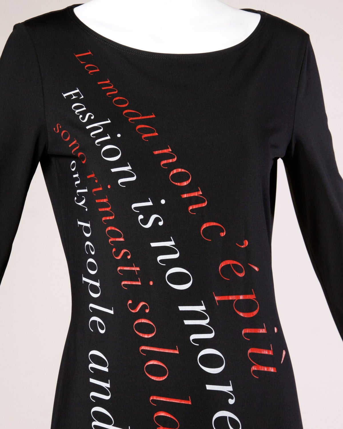 """Vintage black Moschino maxi dress with red and white graphic written in both Italian and English; """"Fashion is no more... only people and clothes remain!"""". Long sleeves and side slit.  Details:  Unlined No Closure/ Fabric Contains"""
