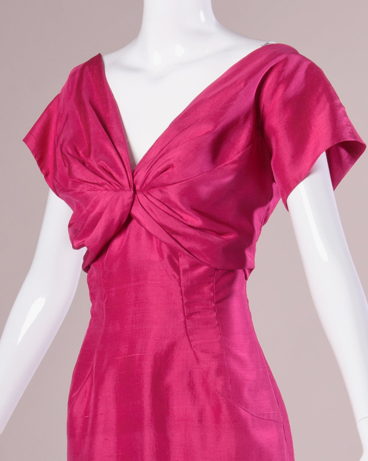 Bright fuchsia silk cocktail dress with short sleeves and gathered bust by Sydney North.