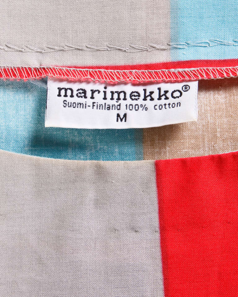Colorful geometric screen printed avant garde dress by Finnish textile designer Marimekko. Drop waist and batwing sleeves.   Details:  Unlined No closure Circa: 80s Label: Marimekko Marked size: M Color: Blue / Red / Gray / Tan Fabric: