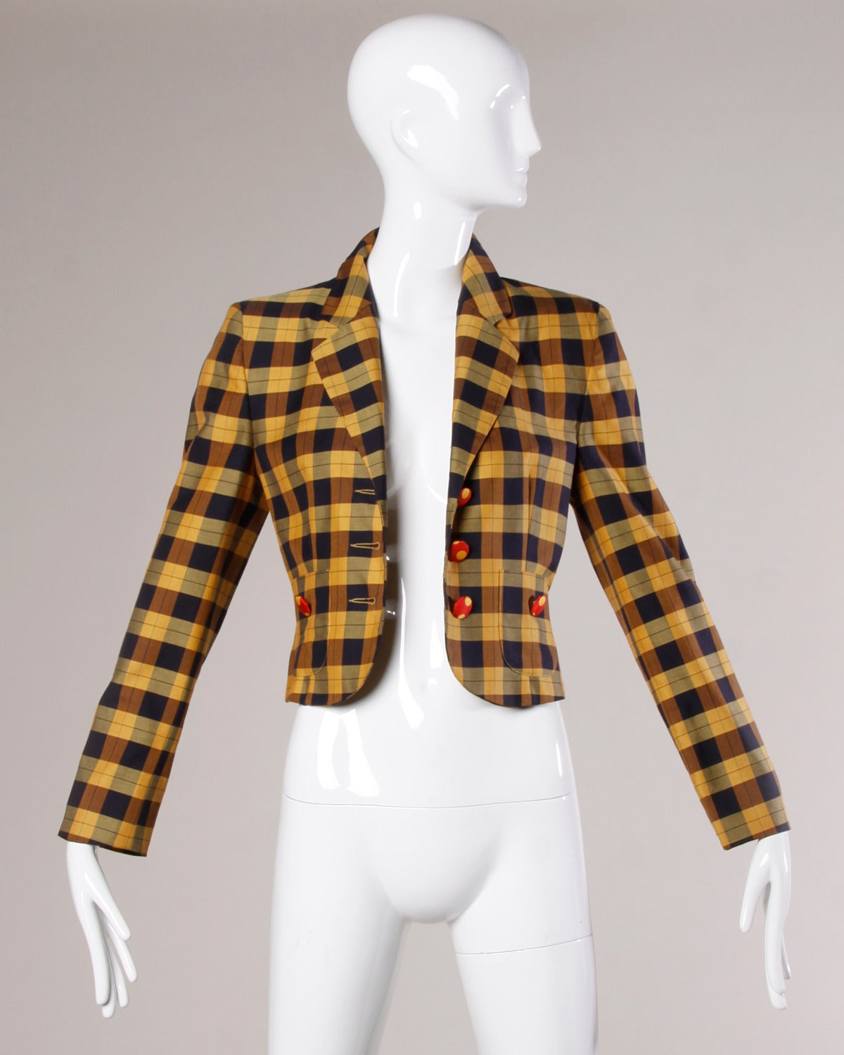Vintage plaid Moschino jacket with polka dot lining and covered buttons.  Details:  Fully Lined Front Pockets Shoulder Pads Are Sewn Into Lining Front Button Closure Marked Size: I 42/ US 8/ GB 10/ F 38/ D 38 Fabric: 100% Rayon Label: