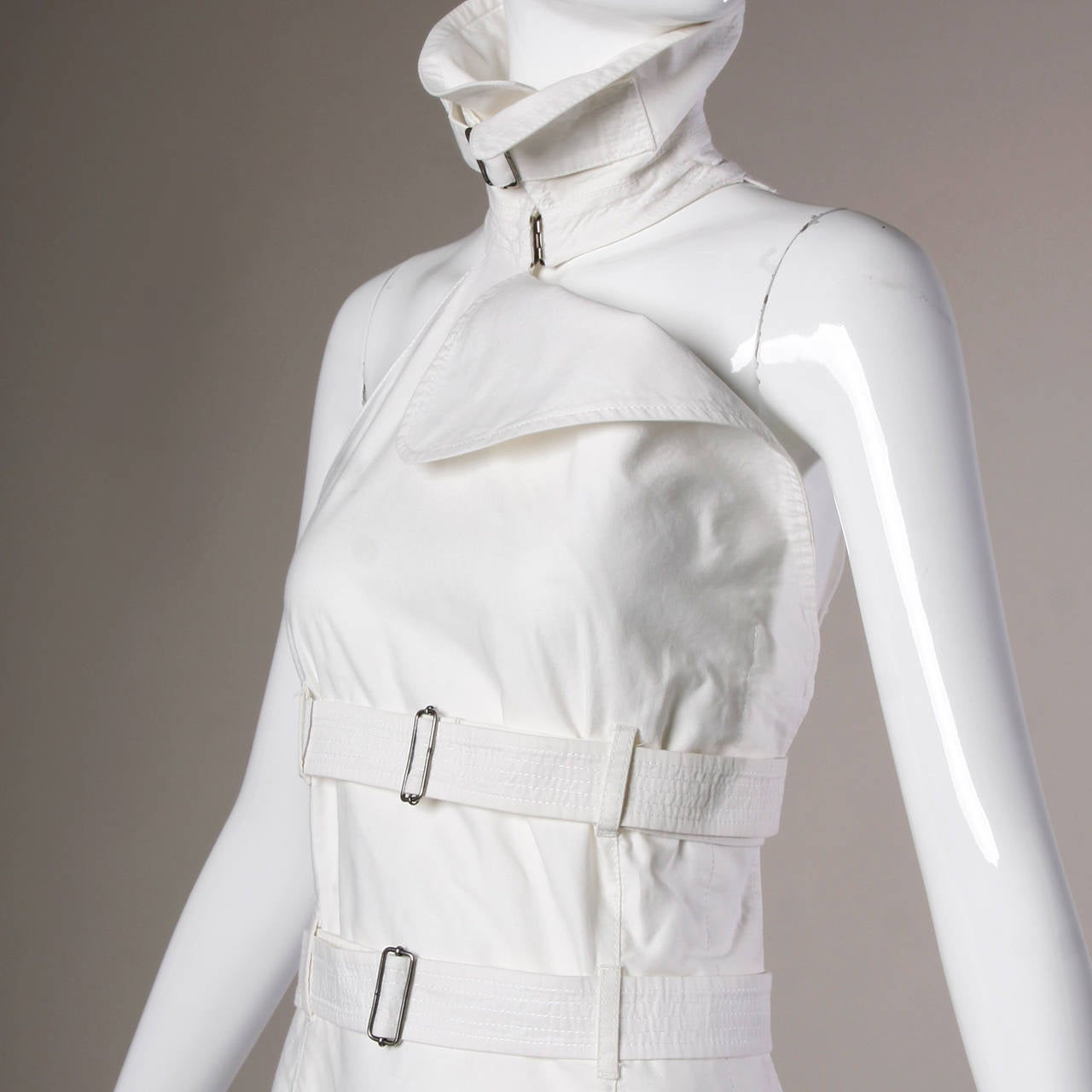 Reduced from $1,295! Iconic vintage straitjacket-inspired bondage dress by Jean Paul Gaultier featuring a high collar with buckle, sleeveless sleeves and a triple belted midsection. All three of the belts are fully adjustable and removable so it