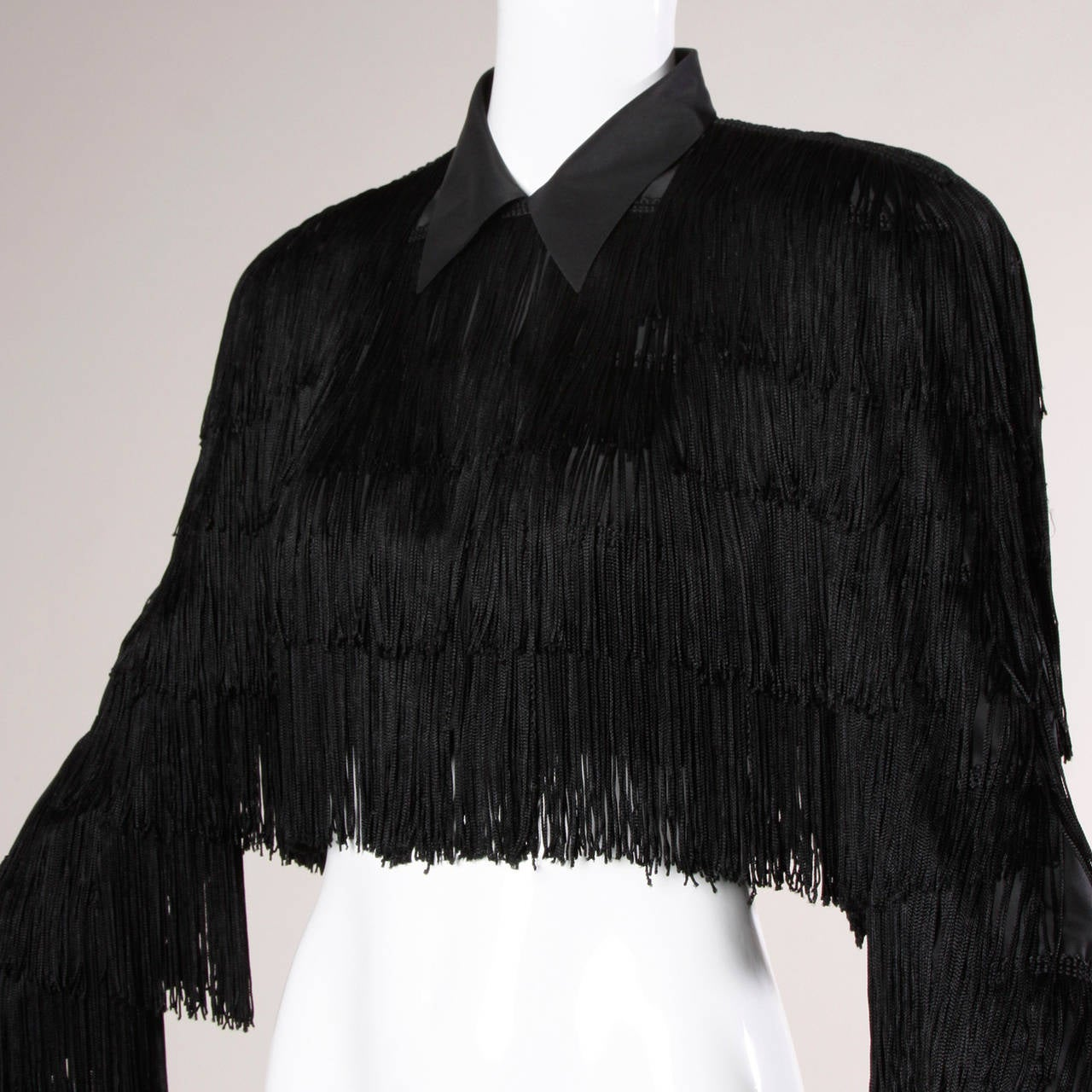 Vintage 1920s-inspired black fringe jacket by Norma Kamali. 