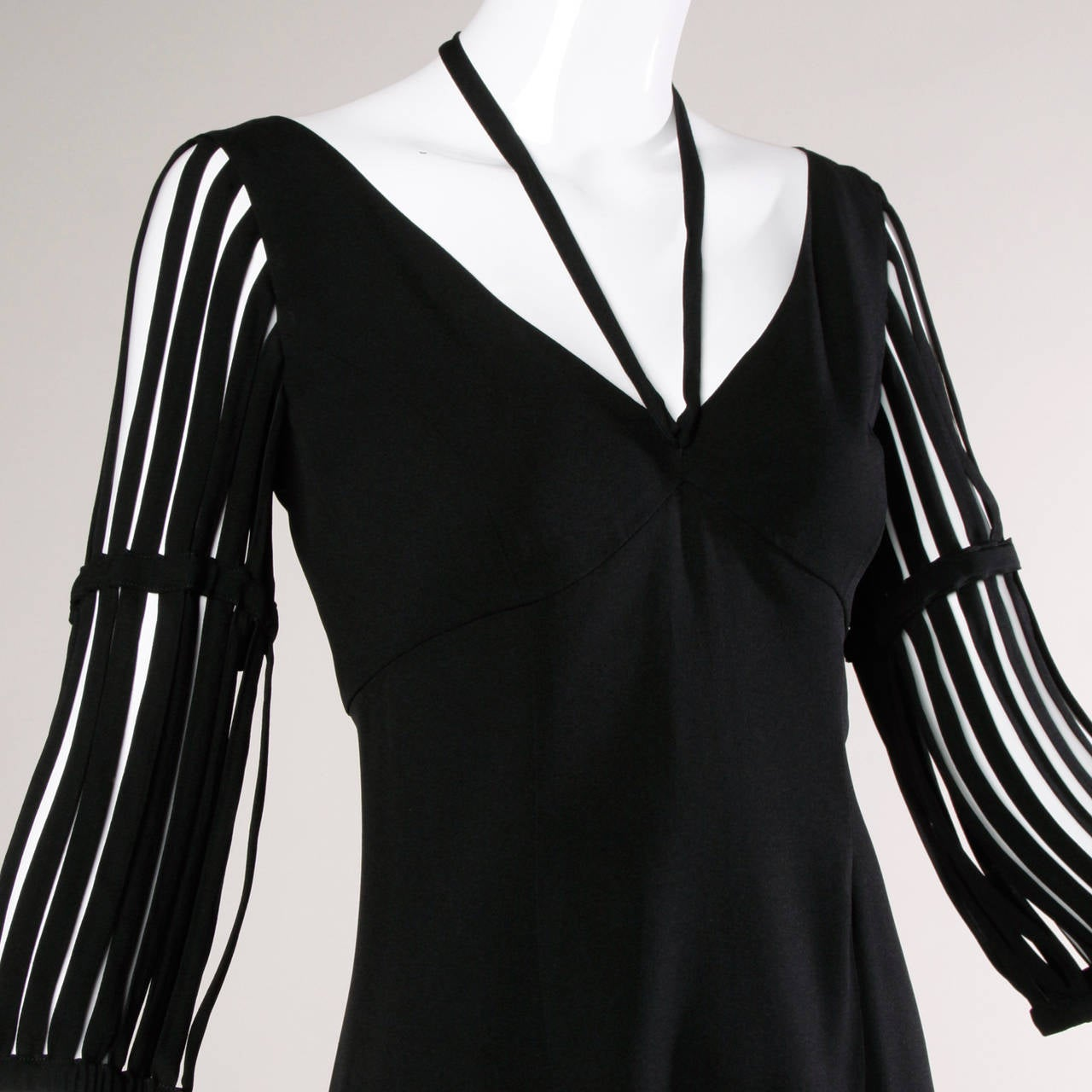 Fantastic Moschino Cheap & Chic little black dress with cut out cage sleeves and a sweet heart bustline. 
