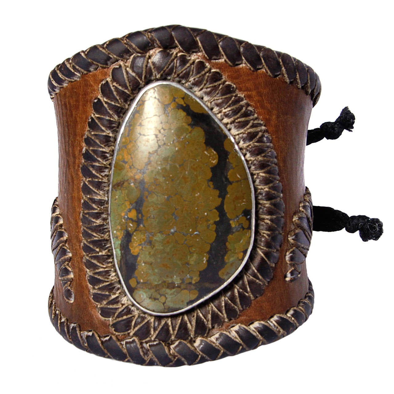 Early 20th Century Native American Leather Ketoh/ Bow Guard Bracelet For Sale