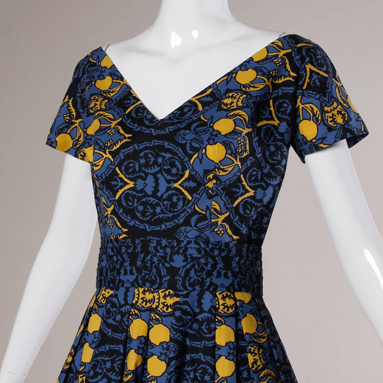 1950s vintage cotton dress with a blue and yellow Provincial screen print and custom stitching. From a French estate!  Details:  Unlined Matching Belt Back Metal Zip and Hook Closure Color: Indigo/ Bright Yellow/ Black Fabric: