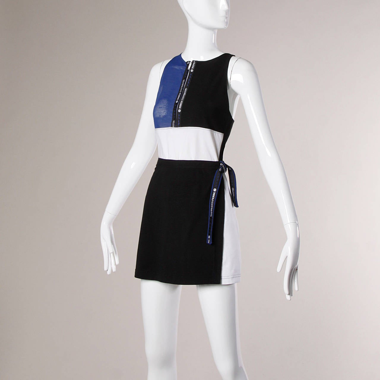 Sporty vintage 2-piece top and skirt ensemble by Gianfranco Ferre in color blocked jersey and mesh panels.  Details:  Unlined Front Zip Closure On Top Hook and Tie Closure On Skirt Marked Size: 30/40 Color: Blue/ White/ Black Fabric: Feels