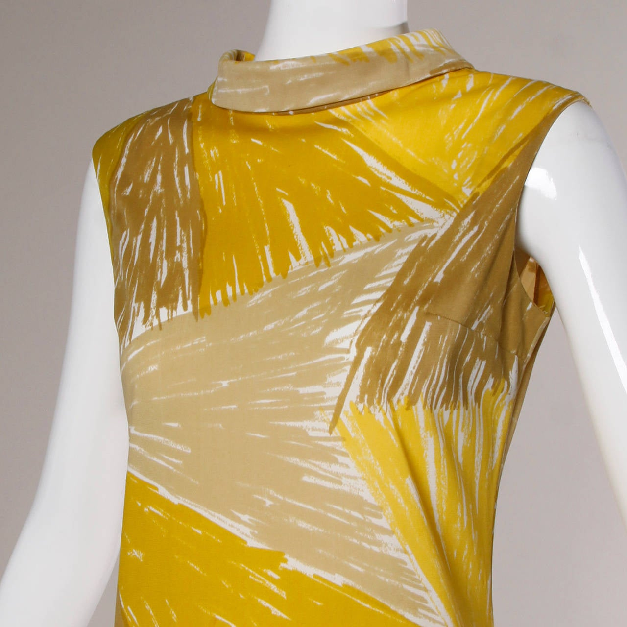 Darling vintage mini dress in shades of yellow by textile designer Vera Neumann.  Details:  Unlined Back Zip and Hook Closure Marked Size: 10 Color: Dark Mustard/ Ash/ Yellow/ White Fabric: 100% Nylon Label: Vera  Measurements:  Bust: