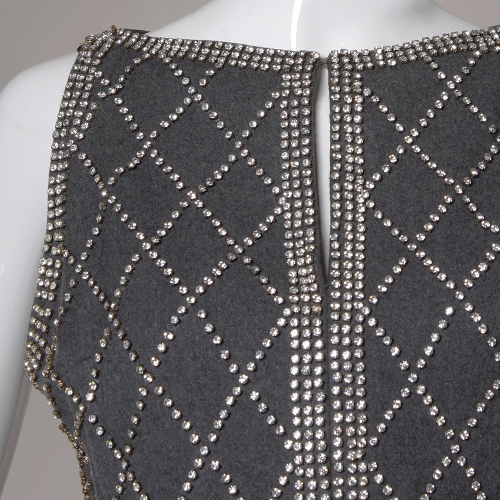 Vintage soft wool maxi dress with gray silk lining and crystal rhinestone embellishment. Sleeveless sleeves and long length.  Details:  Fully Lined Back Metal Zip and Hook Closure Marked Size: 12 Estimated Size: Medium Color: Gray Fabric: