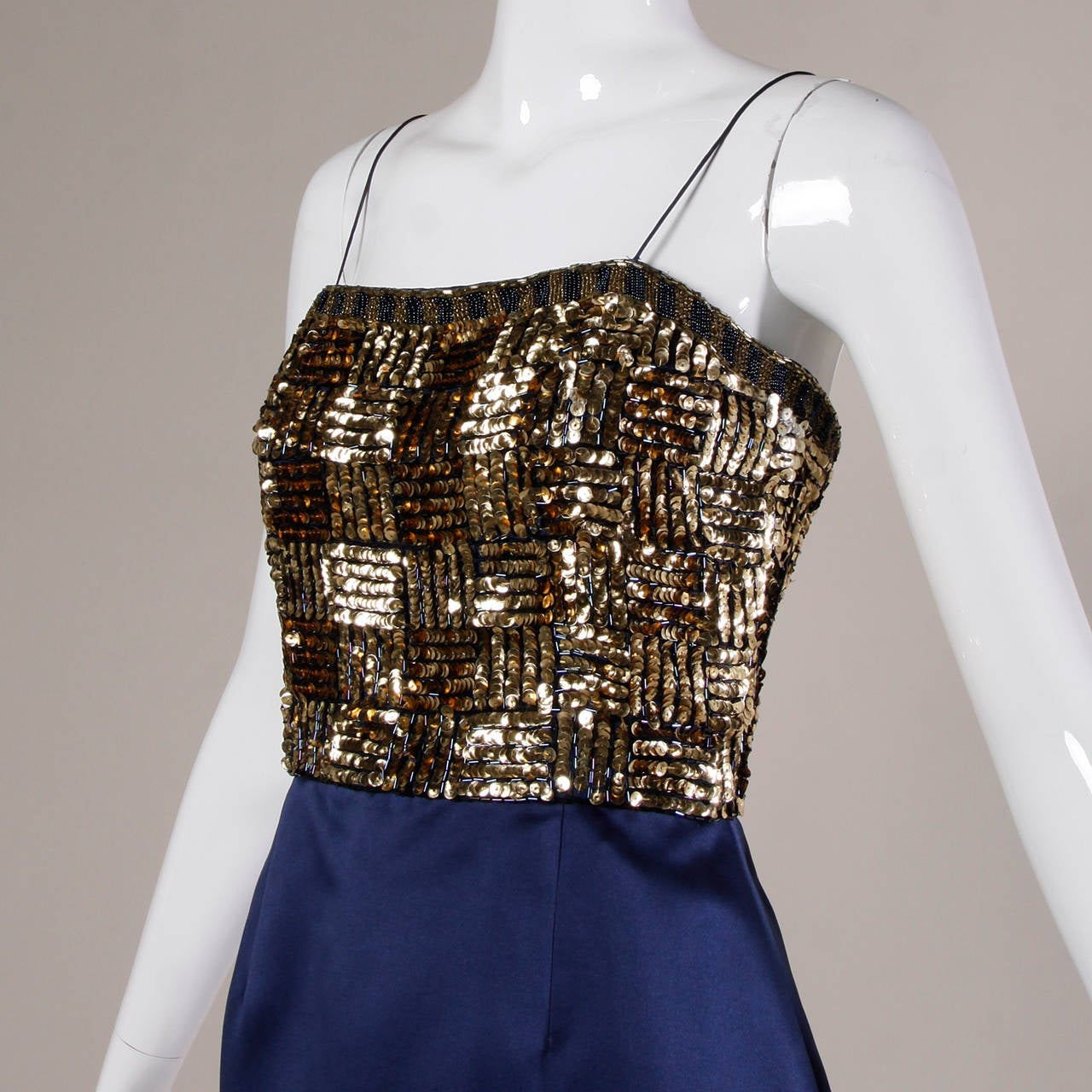 Vintage blue satin cocktail dress with metallic gold sequin and beaded bodice by Bill Blass.