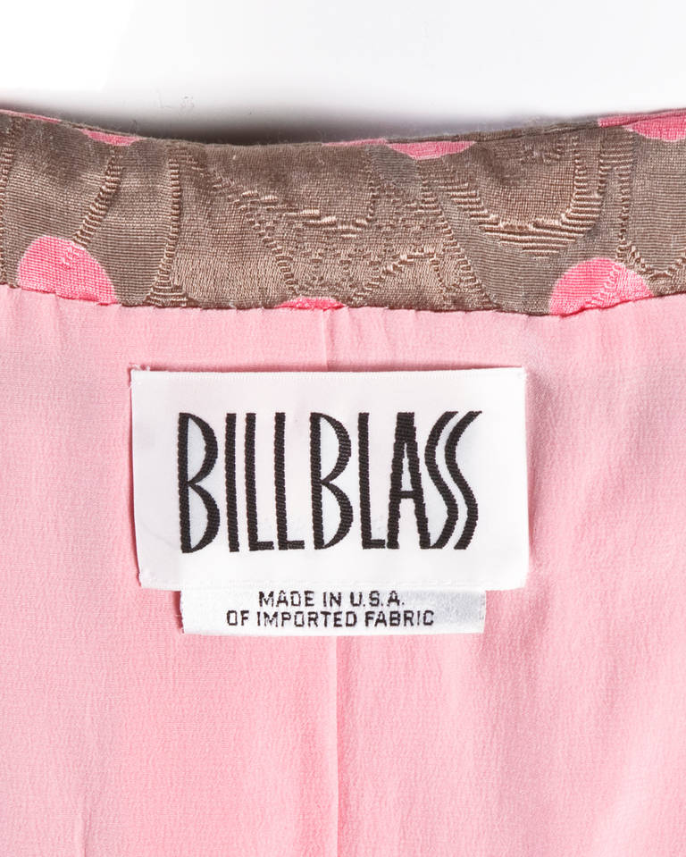 Vintage pink and gray polka dotted quilted skirt suit by Bill Blass. Short sleeve button up jacket with a peplum shape and matching pencil skirt with a side slit. Both pieces are fully lined with darling pink silk crepe.  Details:  Fully