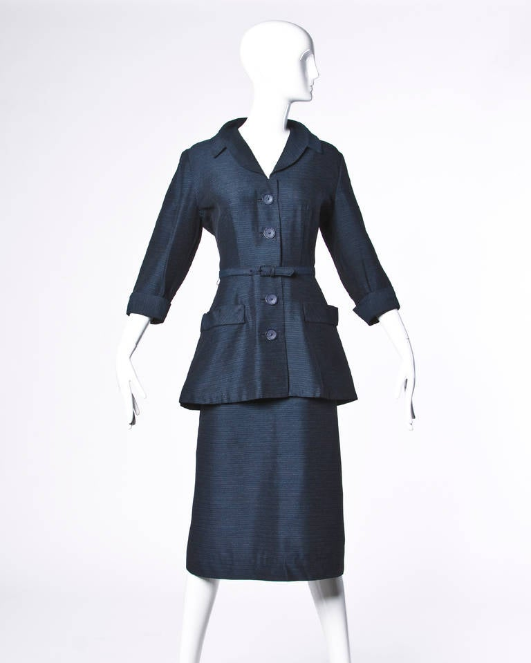 Gorgeous 3-piece 1950s suit includes a jacket, skirt and matching belt. Chic and tailored with rounded notched lapels.