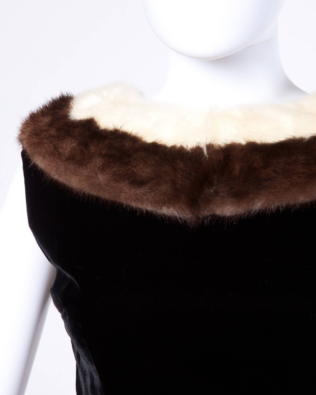 Chic black velvet cocktail dress with a platinum and brown mink fur collar.  Details:  Fully Lined Back Metal Zip Hook and Button Closure Estimated Size: S-M Color: Black/ Brown/ White Fabric: Velvet/ Genuine Mink