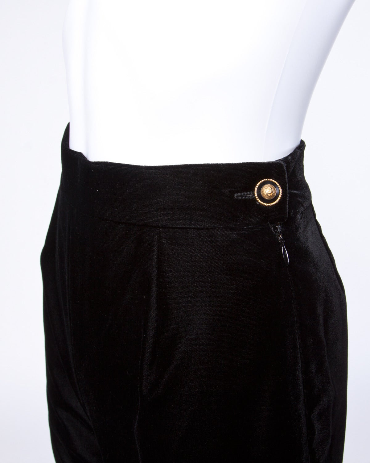 Gorgeous vintage Chanel black velvet drainpipe pants from Autumn of 1993. Decorative gold and black Chanel logo button on the side waist.  Details:  Fully Lined Side Zip and Button Closure Marked Size: 36 Estimated Size: XS Color:
