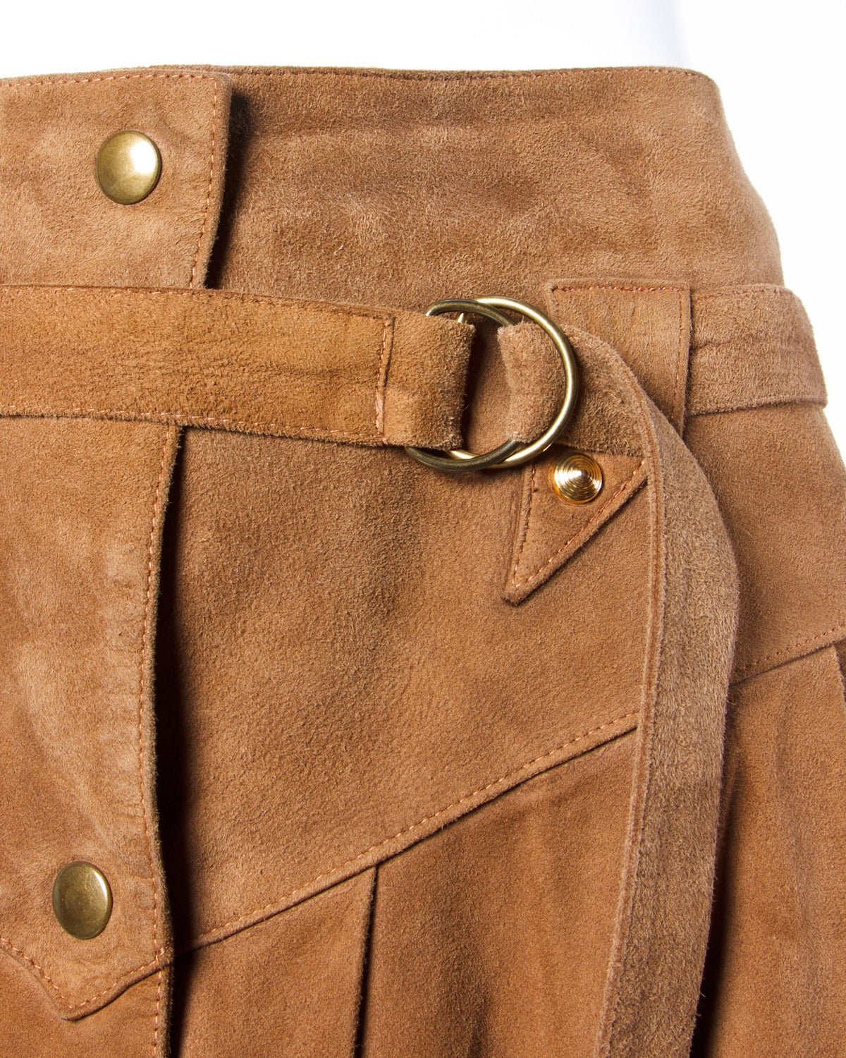 Reduced from $750. Vintage 1980s brown suede leather skirt by Claude Montana pour Ideal Cuir. Silver avant garde hardware and snap up front.  Details:  Fully Lined Attached Matching Belt Front Snap Closure Color: Brown Fabric: Suede