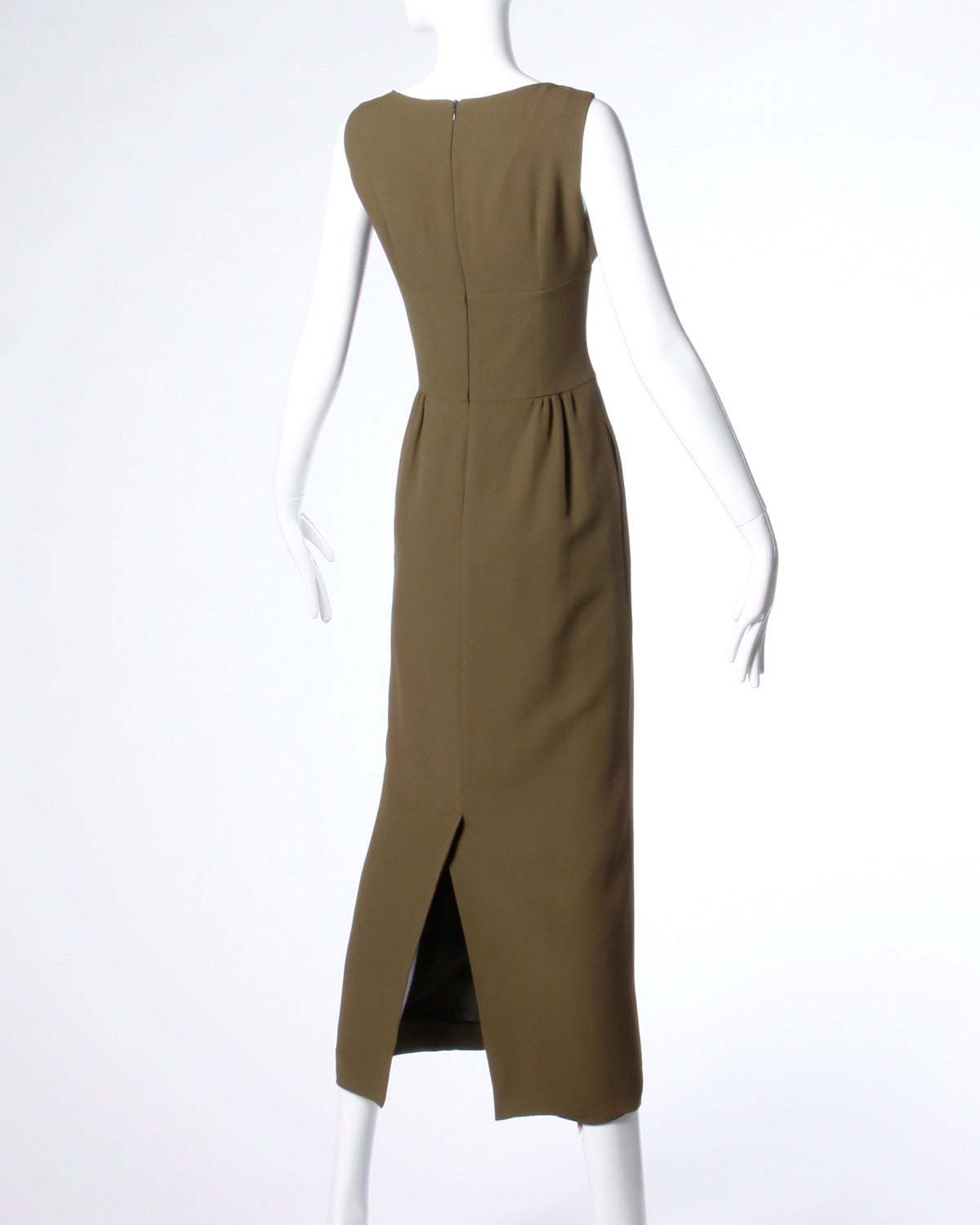 Olive green maxi dress with a high waist and sleeveless sleeves by Moschino.  Details:  Fully Lined Side Pockets Back Zip Closure Estimated Size: M-L Color: Olive Green Fabric: Rayon Blend Label: Cheap & Chic by
