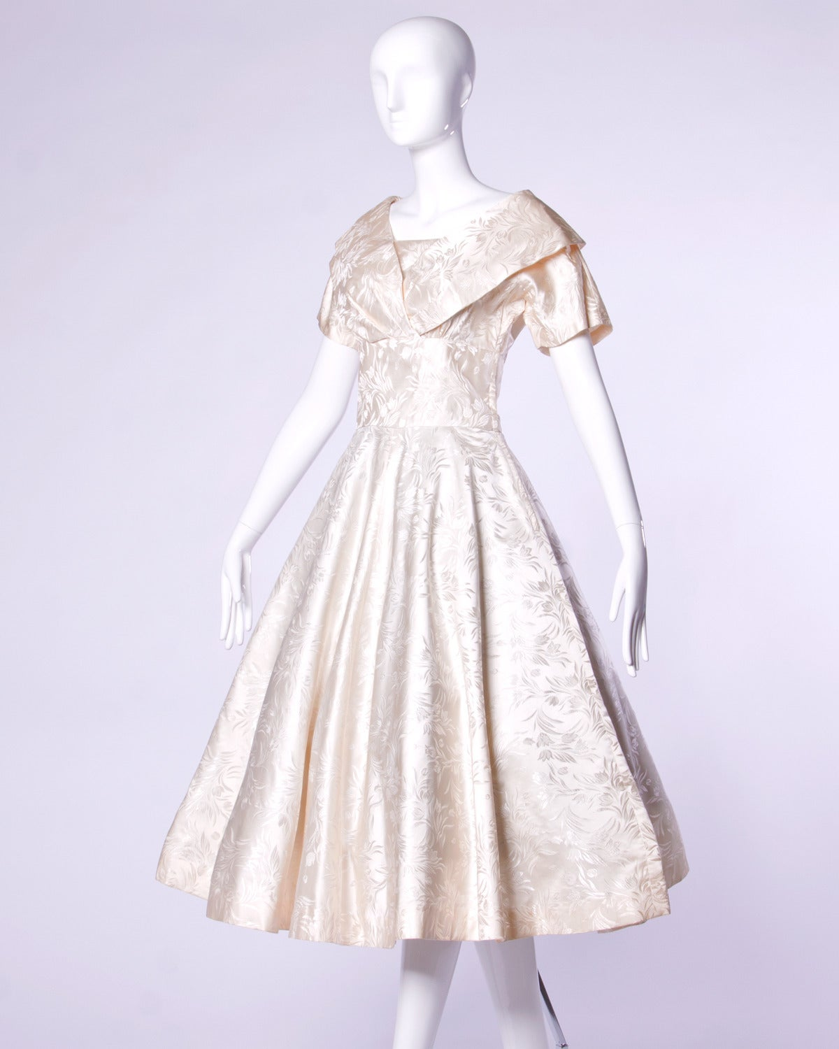 Beautiful and elegant 1950s heavy silk satin formal dress that would make the perfect vintage wedding dress! Embossed floral print and full sweep. 