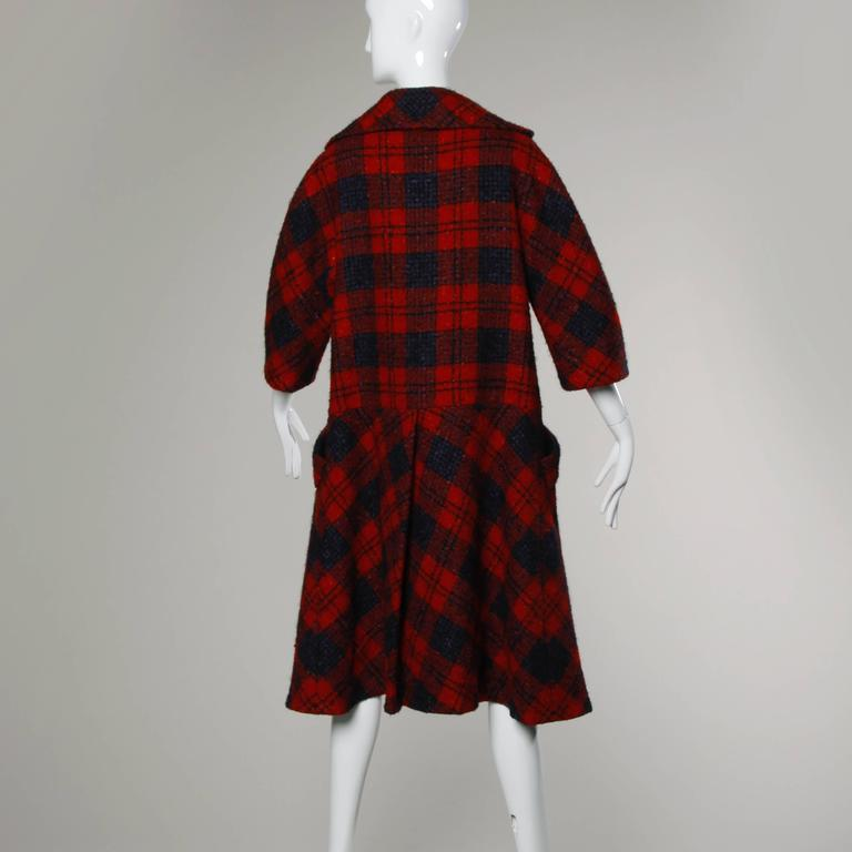 Gorgeous vintage Sarmi for I. Magnin red plaid coat with a drop waist, 3/4 length sleeves and a matching sash belt. Beautifully constructed with couture hand stitched detailing throughout the coat.  Details:  Fully Lined Front Pockets Matching