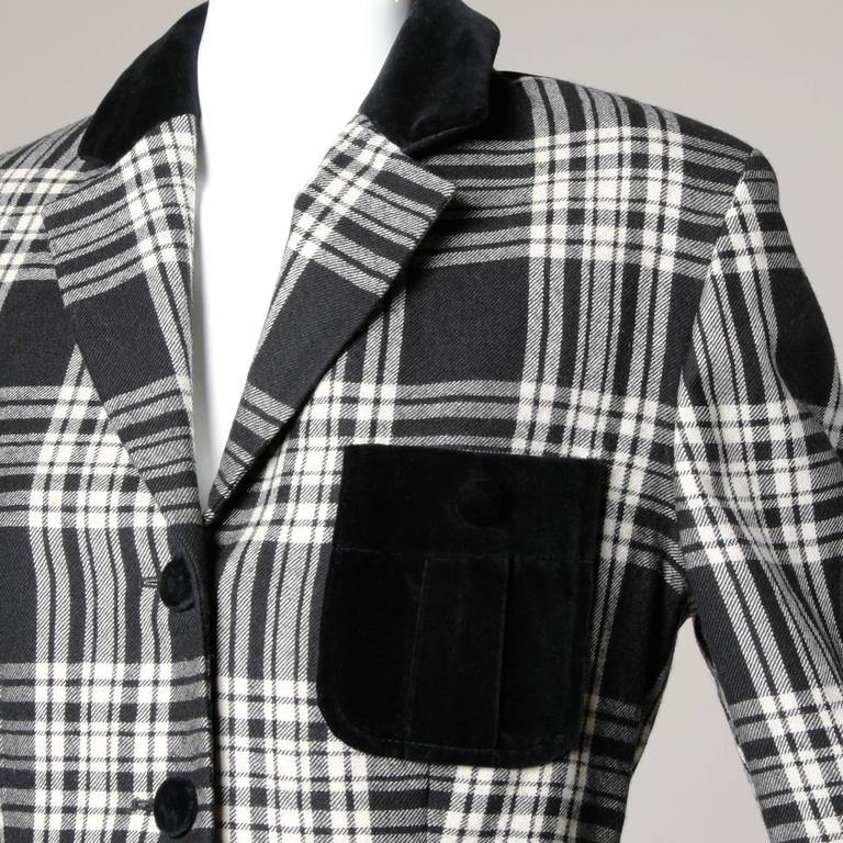 Black and white plaid blazer jacket with black pockets and red lining by GB Moschino.  Details:  Fully Lined Front Button Closure Marked Size: GB 12/ USA 10 Color: Black/ White  Fabric: 100% Wool  Label: Moschino Cheap and