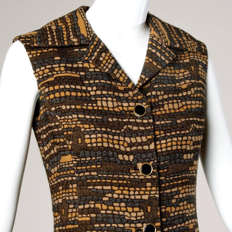Darling vintage button up shift dress or vest by Adele Simpson! Woven midcentury fabric.  Details:  Fully Lined Front Button Closure Marked Size: Not Marked Estimated Size: S-M Color: Black/ Tan  Fabric: Woven Wool Label: Adele Simpson/