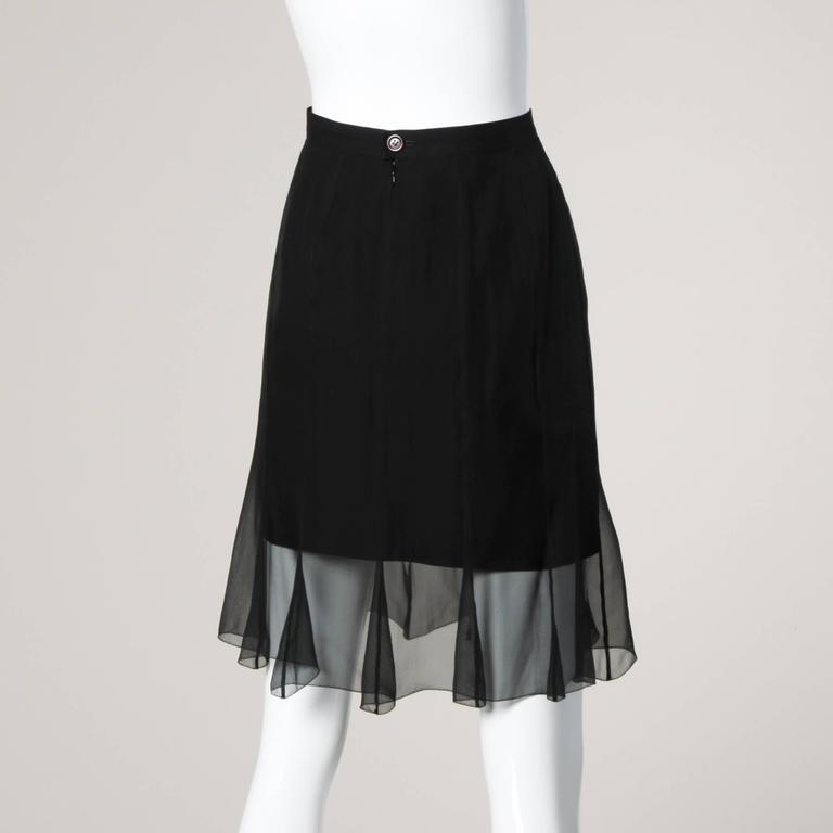 Karl Lagerfeld black skirt with a sheer mesh overlay. Simple and chic.  Details:  Fully Lined Back Zip and Button Closure Marked Size: 40 Estimated Size: Medium Color: Black Fabric: 32% Viscose/ Acetate 61%/ 7% Polyamide Label: Karl