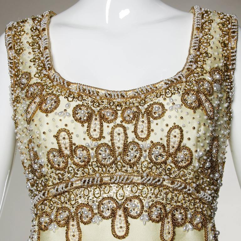 Heavy weight silk and wool blend evening gown with heavy hand-beadwork.