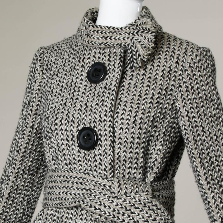 Stunning vintage wool coat by Pauline Trigere with an attached ascot scarf collar and waist tie. Beautiful couture construction with hand-stitched detailing throughout the piece.   Details:  Fully Lined Matching Belt  Front Pockets Front Button