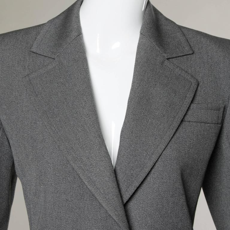 Beautifully tailored gray wool blazer jacket by Saint Laurent . 