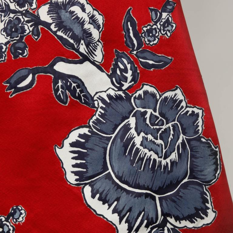 Gorgeous vintage red satin Bill Blass skirt with black, white and gray printed flowers.  Details:  Fully Lined Side Zip and Hook Closure Marked Size: Not Marked Estimated Size: Large Color: Iridescent Gray Blue, Ivory and Cadmium