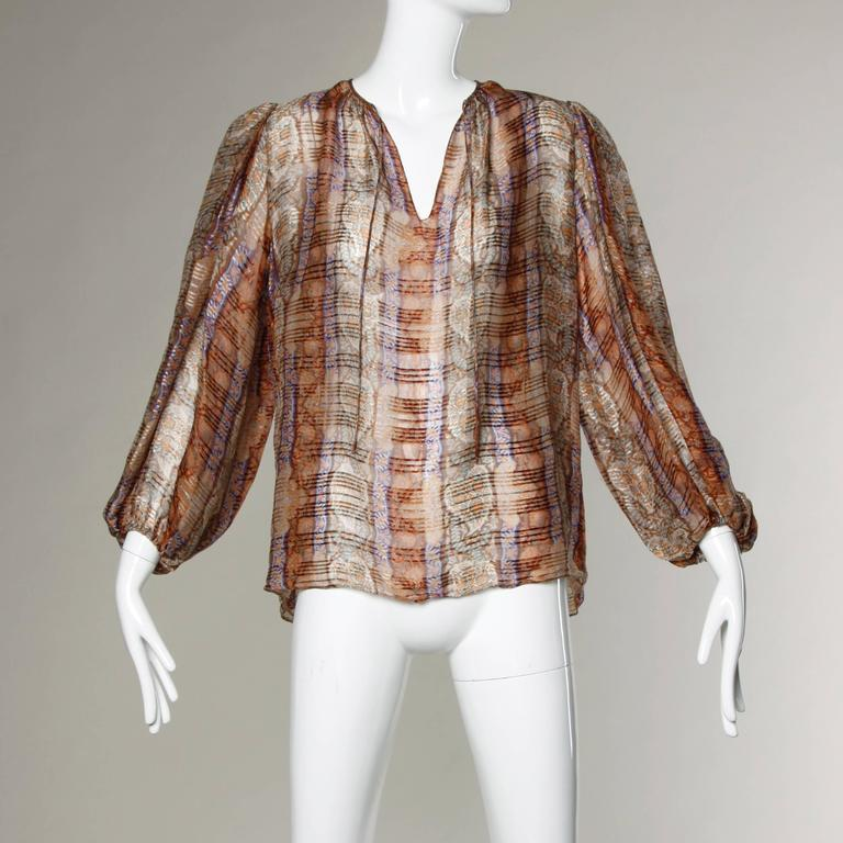 Stunning paper thin sheer printed silk blouse with full balloon sleeves. This has the look and feel of a Pauline Trigere blouse but there is only the Frances Heffernan brand label.