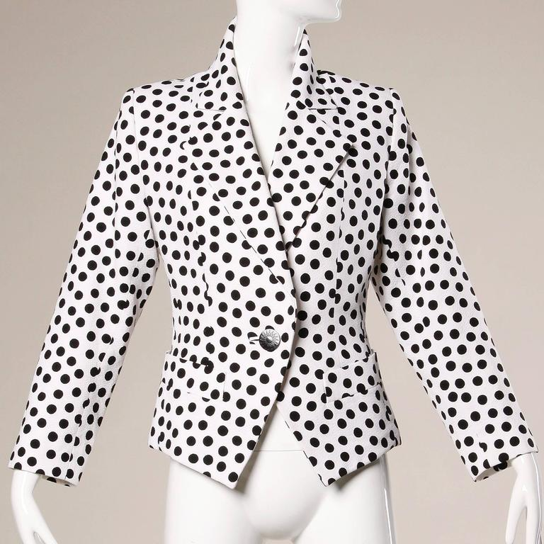 Darling black and white polka dot blazer jacket by Yves Saint Laurent Rive Gauche.  Details:  Fully Lined Front Pockets Front Button Closure Marked Size: F 42 Color: White/ Black Fabric: 100% Cotton Label: Yves Saint Laurent