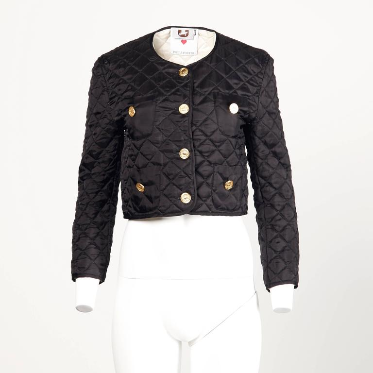 Black quilted Moschino jacket with classic