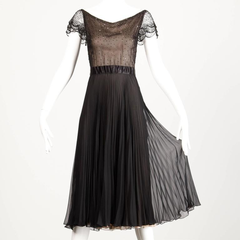 Oscar de la Renta Vintage Black Silk Beaded Dress with Pleated Skirt In Excellent Condition For Sale In Sparks, NV