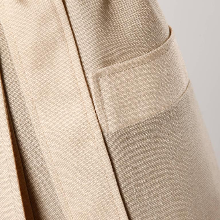 Chic minimalist two tone light weight coat with matching sash by Don Simonelli.  Details:   Fully Lined Front Pockets Tie at Waist Closure Estimated Size: Small-Medium Color: Beige/ Tan Fabric: Feels like Linen Blend Label: Modelia/ Don