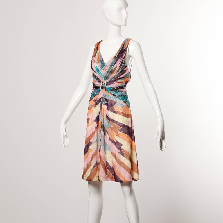 Colorful knit Missoni dress with ruched buckle detail in front and in back.  Details:   Partially Lined in Silk Side Zip Closure Estimated Size: Medium Color: Purple/ Blue/ Tan/ Yellow/ Grey Fabric: 100% Rayon Knit Label: