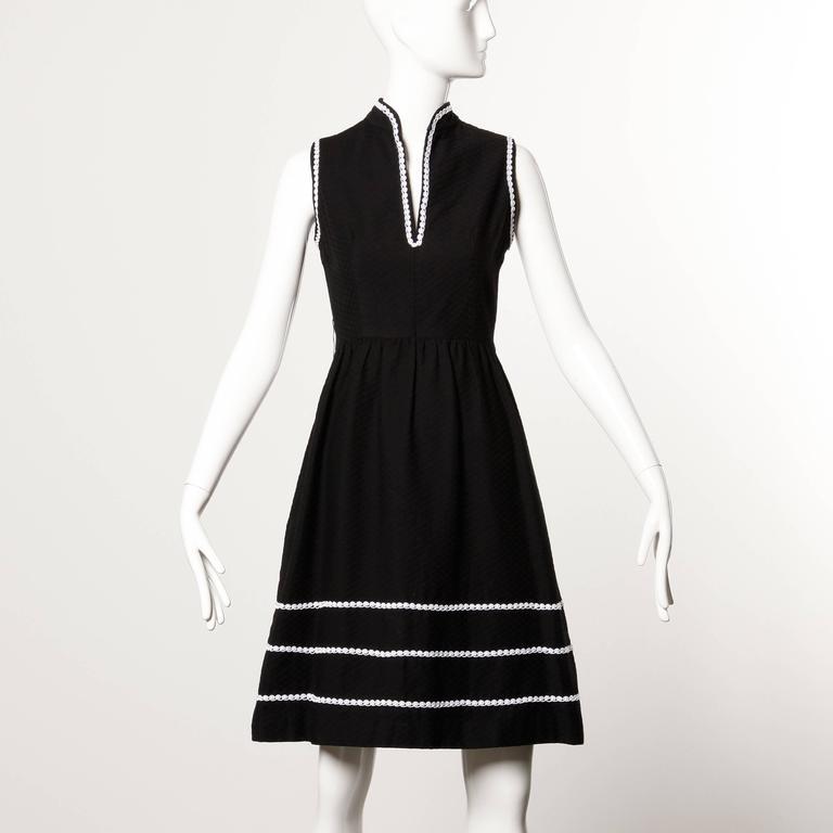 Vintage 1960s Oscar de la Renta sleeveless dress with matching wrap.  Details:   Fully Lined Back Zip with Hook Closure Estimated Size: Small Color: Black/ White Trim Fabric: Heavy Woven Cotton Label: Oscar de la Renta  Measurements: