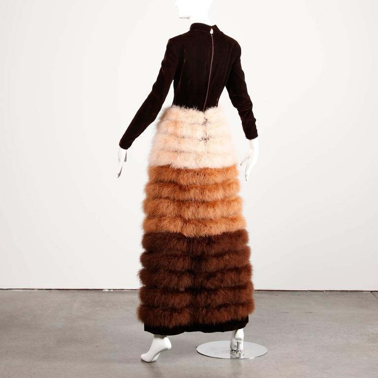 Museum-quality iconic vintage 1960s brown velvet gown with brown, tan and pink marabou feathers by Geoffrey Beene. Long sleeves with zip detail at the wrists and huge voluminous feather skirt.   This dress is missing the label but it is a well