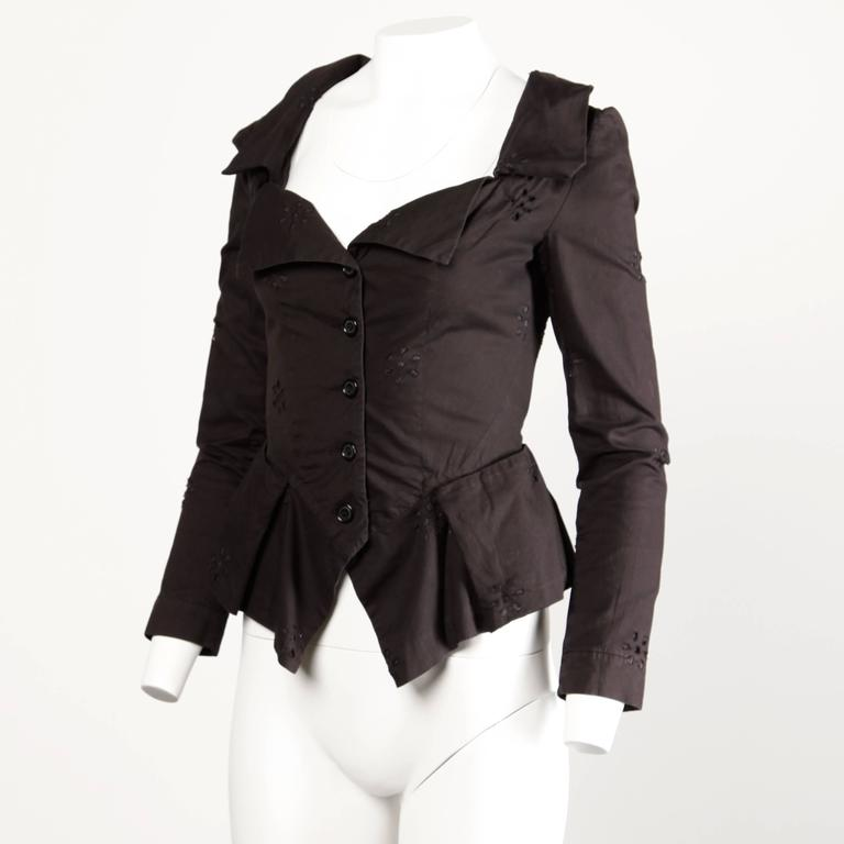 Black eyelet avant garde jacket by Vivienne Westwood with the original tags still attached.