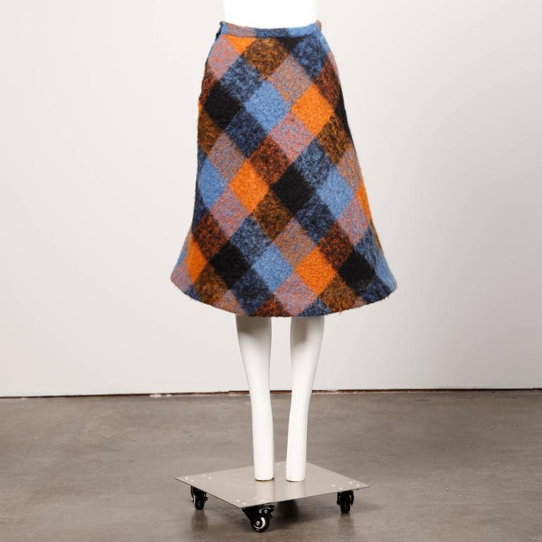 Vibrant plaid mohair midi skirt with horsehair crinoline for added structure. 1960s silhouette with flared hem. By Nelly De Grab.  Details:   Fully Lined  Horsehair Crinoline Side Metal Zip with Hook Closure Estimated Size: Small Color: