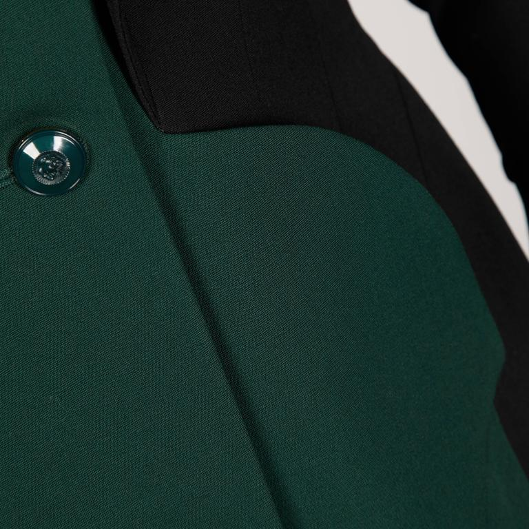 Incredible military-inspired 2-tone vintage jacket by Karl Lagerfeld with front double breasted buttons.  Details:   Fully Lined Front Pockets Button Front Closure Marked Size: 40 Color: Black/ Dark Green Fabric: Wool Label: Karl