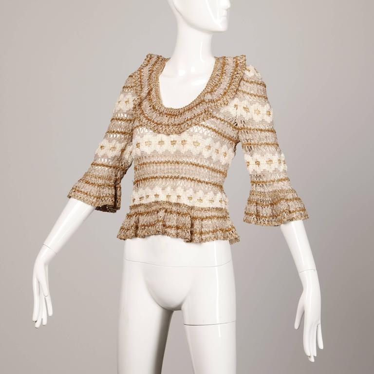 Amazing vintage metallic sweater top by Lillie Rubin. Bell sleeves and ruffled scoop neck.