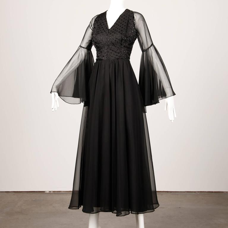 Black chiffon dress with sheer bell sleeves and beaded bodice with a polka dot design by Harriette's Las Vegas. Full sweep and chiffon skirt.  Details:   Fully Lined Back Zip with Hooks Closure Marked Size: Unmarked Estimated Size: