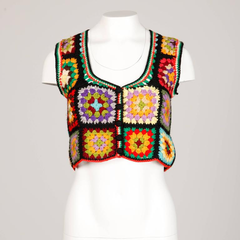 Vibrant wool vest or top in hand crocheted Granny Squares by Adolfo for I. Magnin. Unlined. Made in the British Crown Colony of Hong Kong. The marked size is large but this should fit sizes small-medium as well.