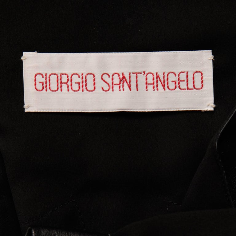 "Slightly sheer button up blouse with black leather patchwork detail by Giorgio Sant'Angelo. Unlined with front snap closure. Fits like a modern size small-medium. The bust measures 40"", waist 40"", hips 41"", shoulders 15.5"","