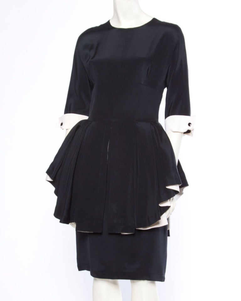 Extraordinary Bernard Perris black and off white 100% silk dress with a ruffled peplum and 3/4 length sleeves. Stunning couture construction with hand stitching on the silk interior. Rear zip closure and fully lined in silk. Fits like a modern size