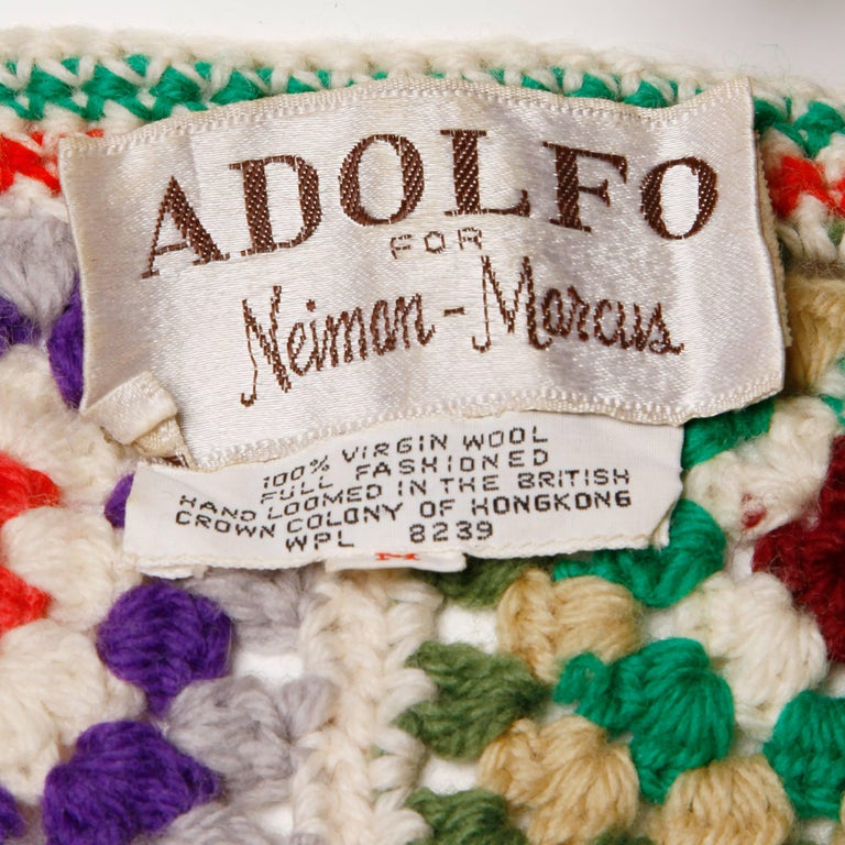 Vibrant 100% wool vest or top in hand crocheted Granny Squares by Adolfo for Neiman Marcus. Unlined. Made in the British Crown Colony of Hong Kong. The marked size is large but the piece will also likely fit a small-medium in addition to a smaller