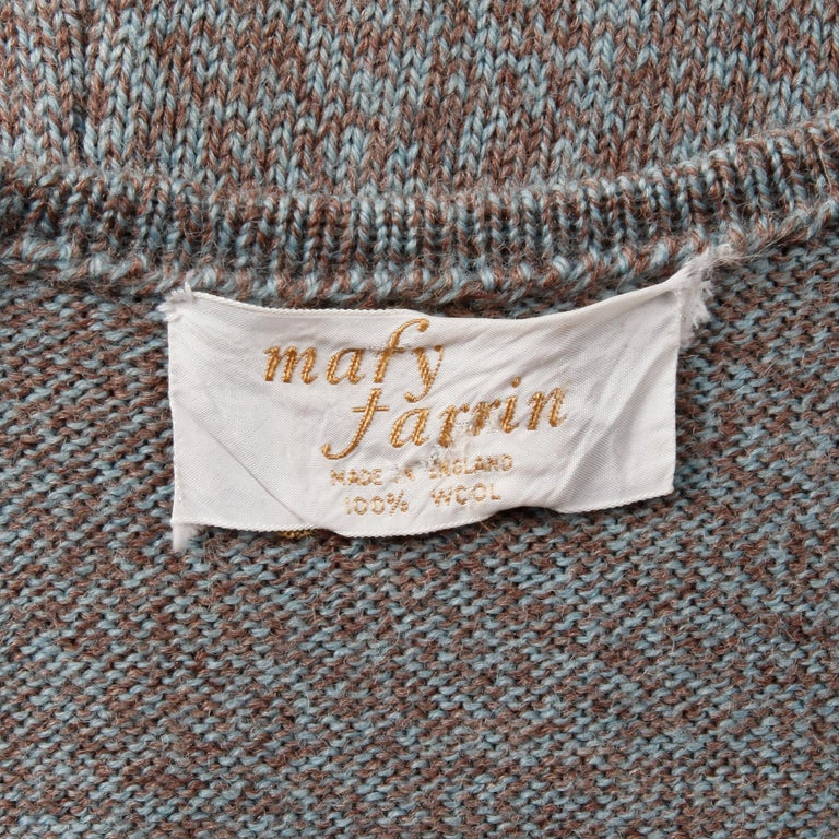 Mary Farrin vintage 1970s knit vest or waistcoat with a lace up front. Unlined with front tie closure (pulls on over head). 100% wool. Fits like a modern size small-medium. The bust measures 29-37