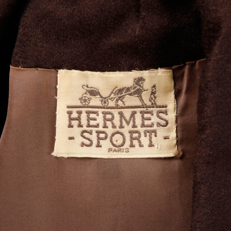 Absolutely stunning vintage coat dress by Hermes Sport in what feels like a chocolate brown cashmere (fabric content is unmarked). Couture hand stitched creamy brown silk lining. Flawless construction and matching